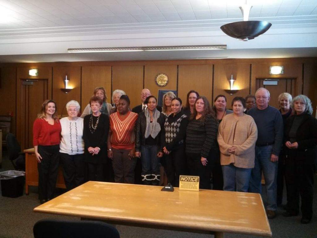 group of CASA volunteers standing in courtroom